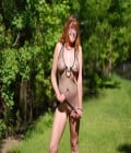 Mature Marlene Flint showing her cunt in the woods